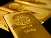 Tertekan Penguatan Data dan Ekuitas AS Harga Emas Turun